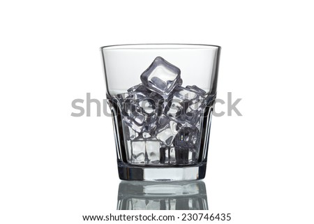 glass for whiskey with ice cubes isolated on white background - stock photo
