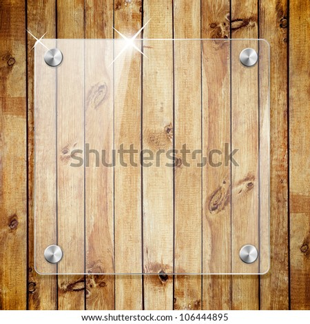 Glass framework on wooden texture background