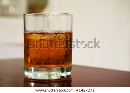 glass from whiskey on a wooden table - stock photo