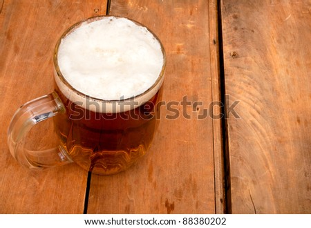 Glass Full of Beer on Old Wooden Table - stock photo