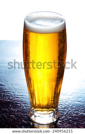 Glass full of beer over white background. Alcohol conceptual image - stock photo