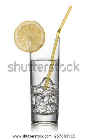 glass full of fresh sparkling water with lemon, on white background - stock photo