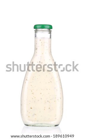 Glass full of sauce. Isolated on a white background. - stock photo