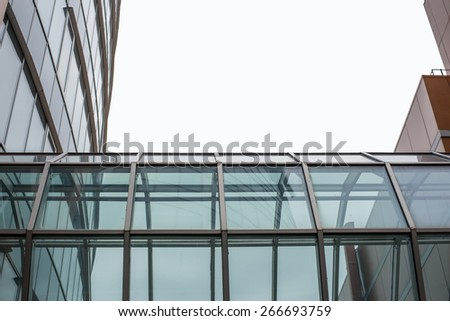 Glass gallery between buildings. Isolated on white background