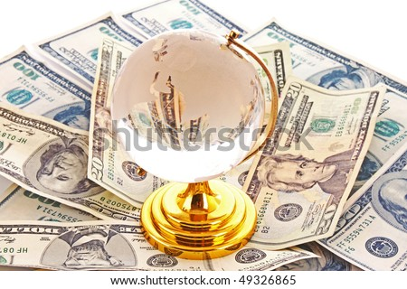 Glass  globe and many dollars - stock photo