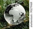 Glass globe Christmas tree on the background mast - stock photo