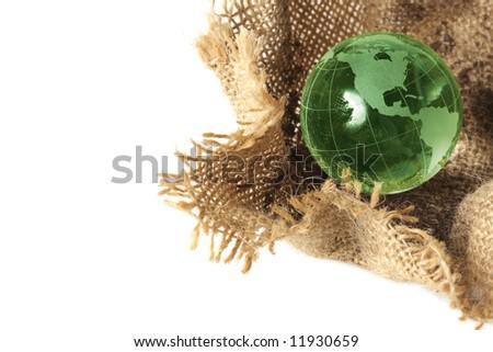 Glass globe in burlap sack - stock photo