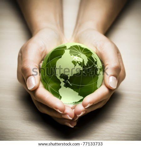 glass globe in hand - stock photo