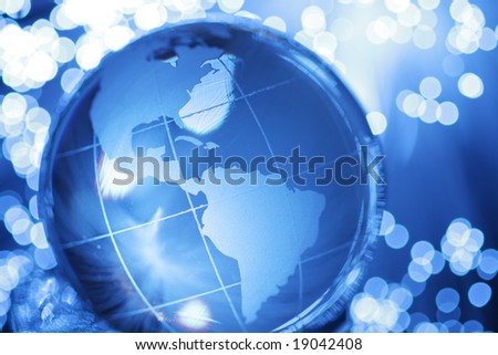Glass globe in lights - stock photo