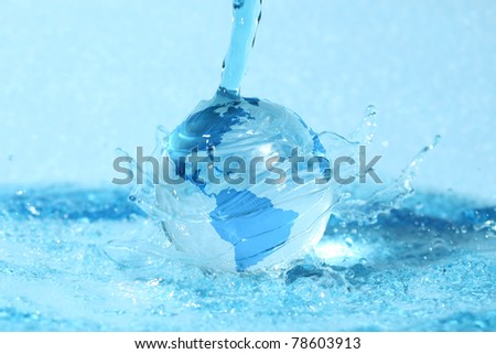 Glass globe in water - stock photo