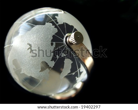 Glass globe on black background.