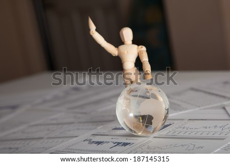Glass globe on the chart papers. - stock photo