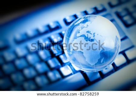 Glass globe over keyboard , global communication concept. - stock photo