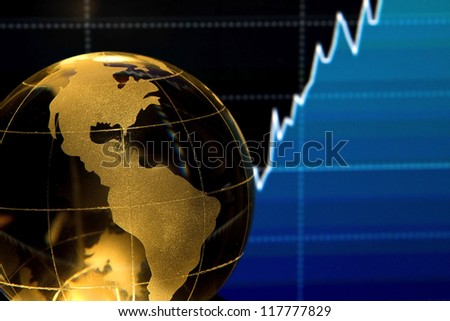 Glass globe over stock data on computer screen - stock photo
