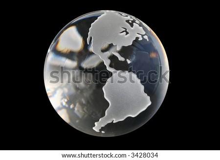 Glass globe with black background - stock photo