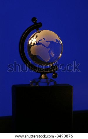 Glass globe with blue background