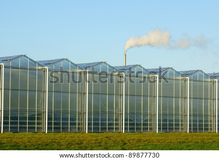 Glass greenhouse with greenhouse gas