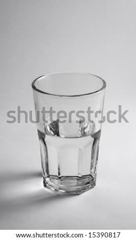 Glass half empty or half full. You decide! :) - stock photo