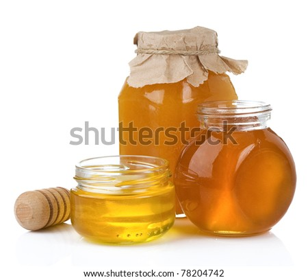 glass jar and pot of honey with stick isolated on white background - stock photo