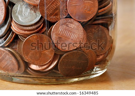 glass jar filled with American coins.  Extreme closeup ideal as background - stock photo