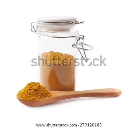 Glass jar filled with the yellow curry powder isolated over the white background - stock photo