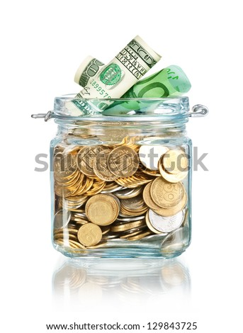 Glass jar for tips with money isolated on white