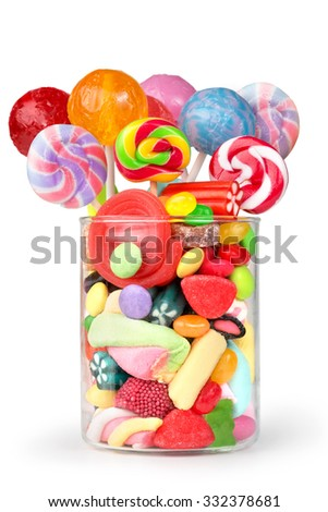 glass jar full of candy and lollipops - stock photo