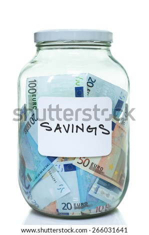 Glass jar full of Euro with a savings label on it - stock photo