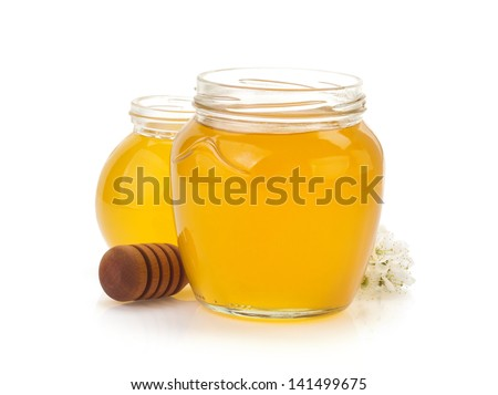 glass jar full of honey and stick isolated on white background - stock photo