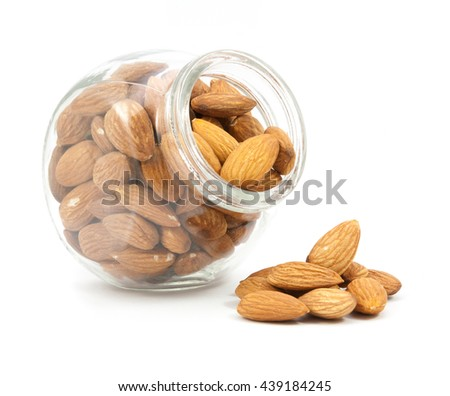 Glass jar of almonds isolated on white background - stock photo