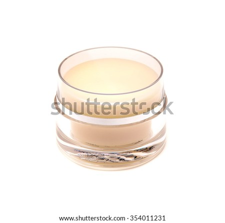 glass jar of face cream isolated on white background - stock photo