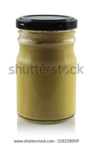 Glass jar of mustard isolated on white background. - stock photo