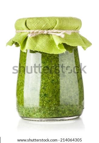 Glass jar of pesto sauce isolated on white - stock photo
