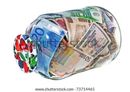 glass jar or bank full of different nominal money isolated over white Concept glass bank is the most secure Bank or imaginary, safety - stock photo