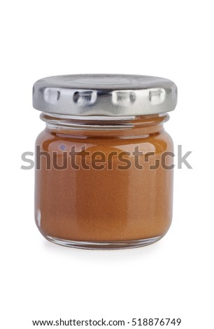 Glass jar with chocolate spread isolated on white background
