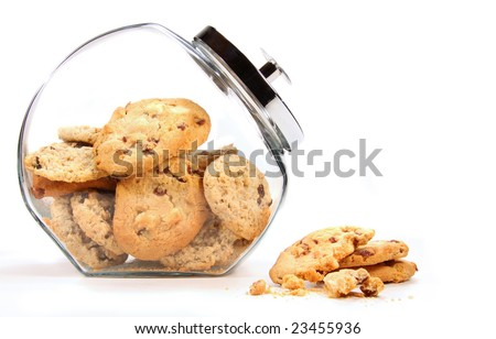 Glass  jar with cookies against a white background - stock photo