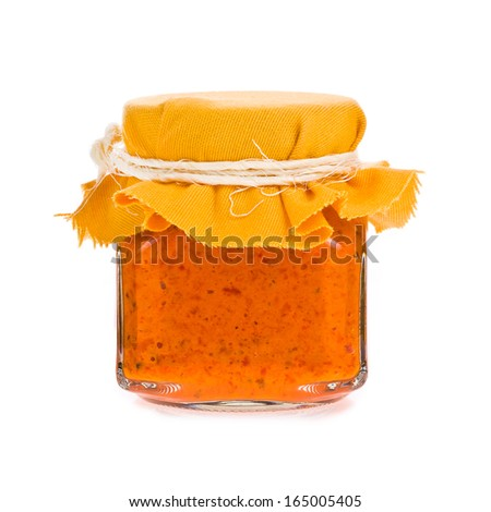 glass jar with paprika sauce isolated on white background - stock photo