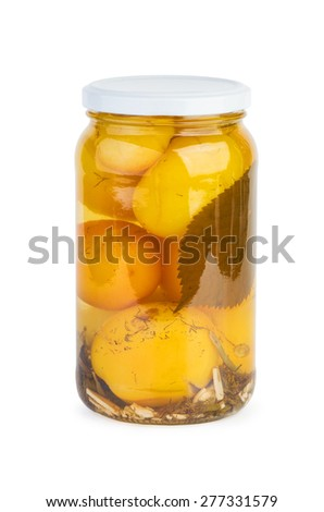 Glass jar with pickled yellow tomatoes isolated on white - stock photo