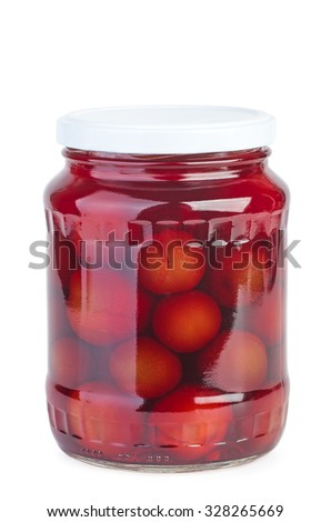 Glass jar with preserved plums isolated on white background - stock photo