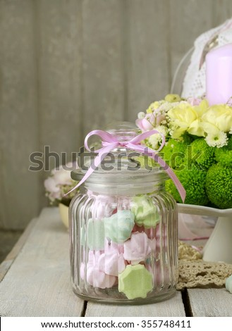 Glass jar with sweets - stock photo