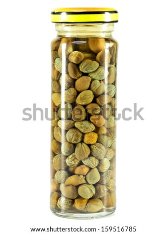 Glass jar with tinned capers - stock photo