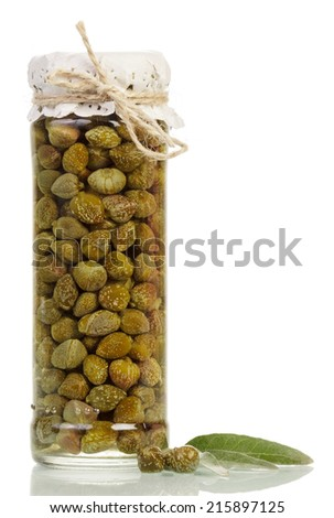 Glass jar with tinned capers isolated on white background - stock photo