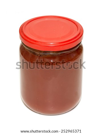 glass jar with tomato juice on a white background - stock photo