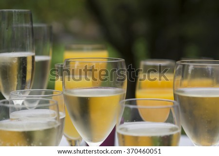 Glass jars filled with champagne and orange juice