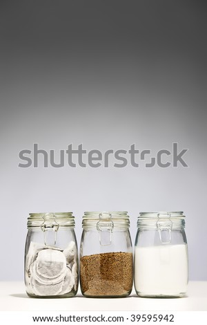 Glass Jars of Coffee Tea and Sugar - stock photo