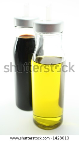 Glass jars of olive oil and balsamic vinegar.