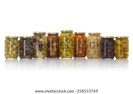 Glass Jars of Pickled Vegetables Isolated on White Background - stock photo
