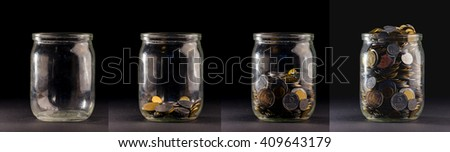 Glass jars with coins like diagram, isolated - savings concept - stock photo