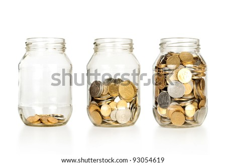 Glass jars with coins like diagram, isolated - savings concept