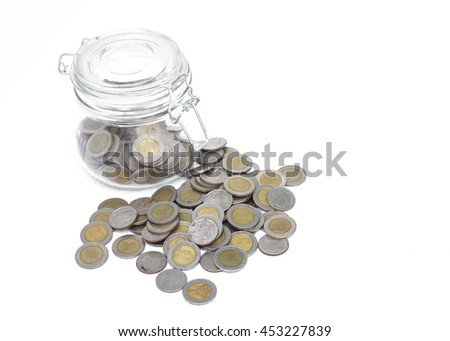 Glass jars with coins money on white background, savings concept.